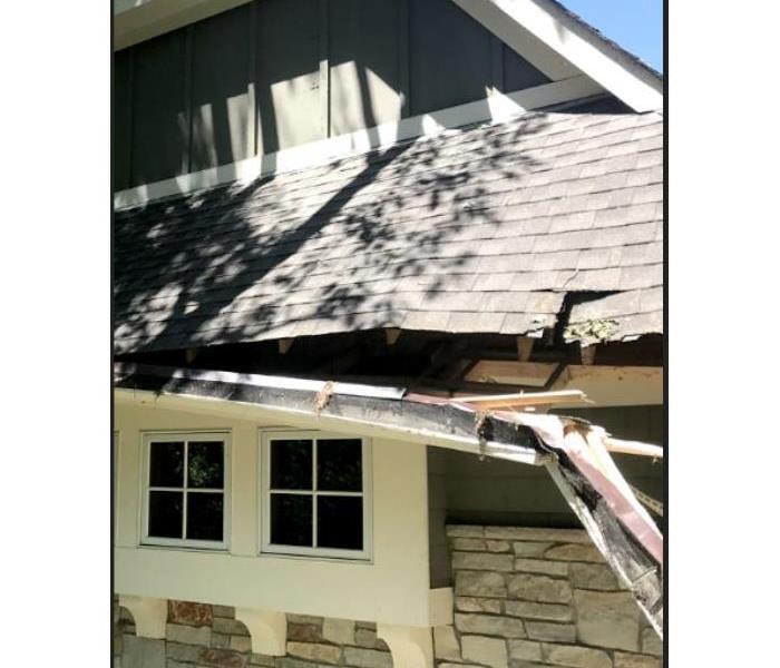 This roof was damaged by a falling tree