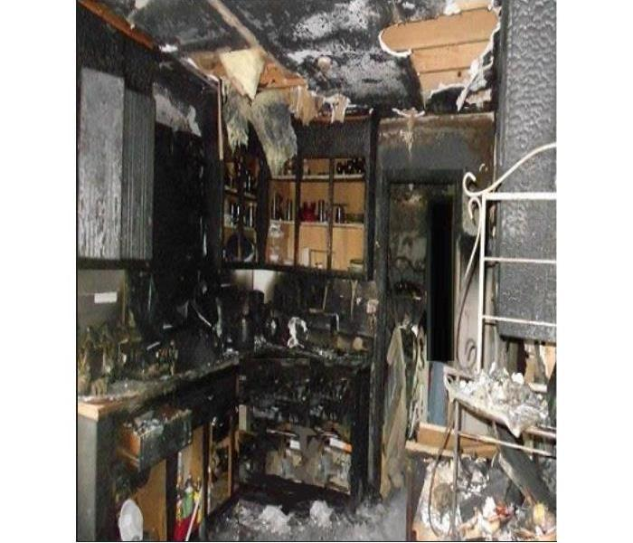 Fire stricken home, burnt counter tops, cabinets, & ceiling